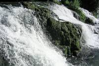 Water flows over rocks at the Rhine Falls of Schaffhausen