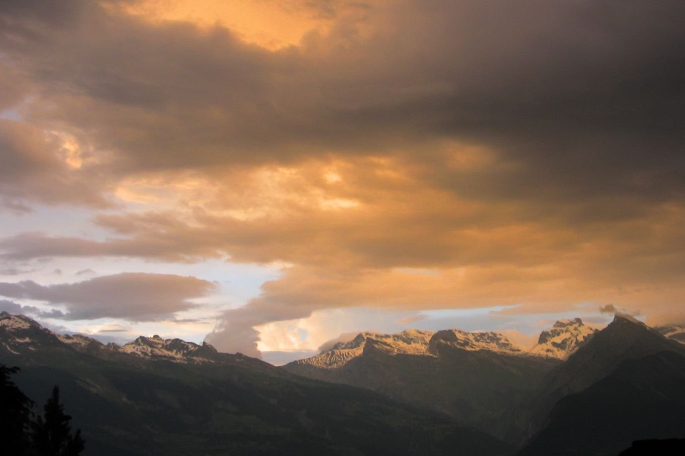 Stormy atmosphere and clouds form the picture of the mountains